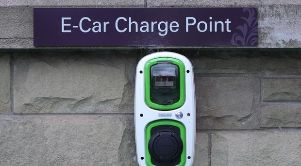 An electric car charging point (Niall Carson/PA)