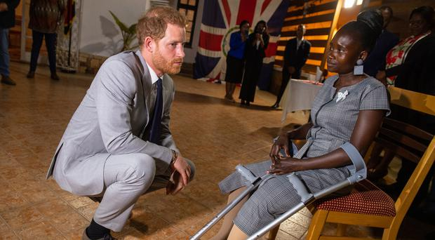 The Duke of Sussex meets landmine victim Sandra Tigica, who Princess Diana met on her visit to Angola 1997, during a reception at the British Ambassadors Residence in Luanda, Angola, on day five of the royal tour of Africa (Dominic Lipinski/PA)