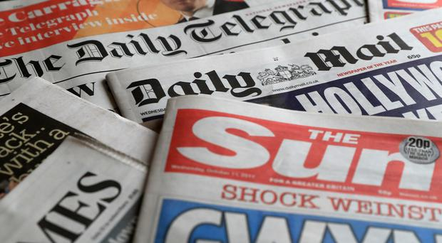 A collection of British newspapers.