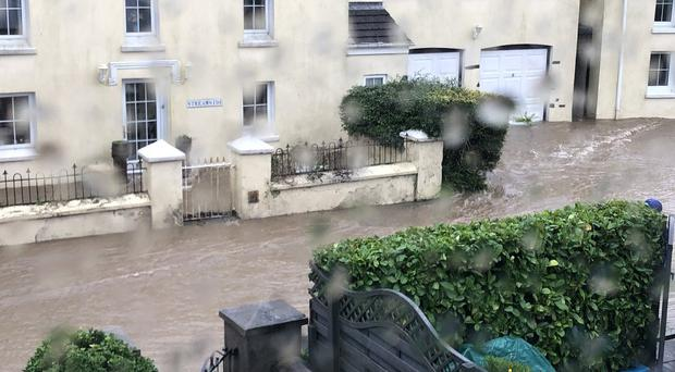 Flooding on Glen Road, Laxey, Isle of Man, as flash flooding caused problems (Jo Bersee-Mills/Twitter/PA)