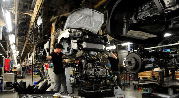 Workers at Nissan working on the Qashqai in Sunderland (Owen Humphreys/PA)