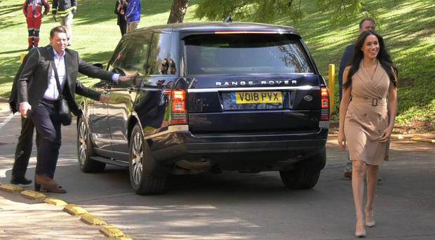The Duchess of Sussex walks from a UK registered Range Rover as she arrives to visit the University of Johannesburg (Videograb/PA)