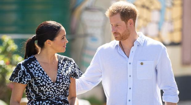 The Duke and Duchess of Sussex during a visit to the Nyanga Township in Cape Town (Dominic Lipinski/PA)