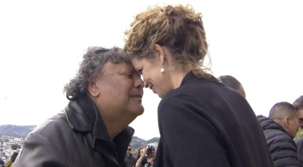 British High Commissioner Laura Clarke receives a hongi from a local when she visited the town of Gisborne, New Zealand (TVNZ/AP)