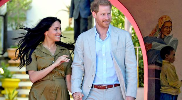 The Duke and Duchess of Sussex in the Bo Kaap area of Cape Town, South Africa, on day two of their tour of Africa (Toby Melville/PA)