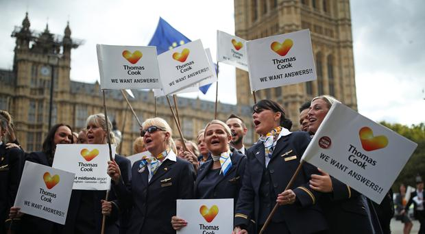 Ex-Thomas Cook employees protest outside Parliament (Yui Mok/PA)