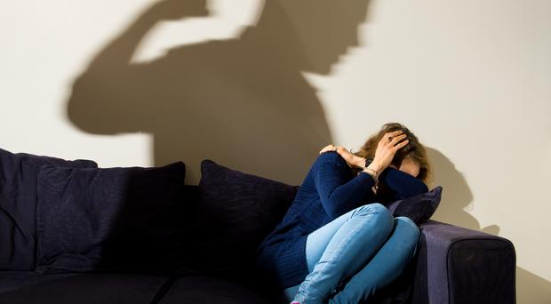 MPs have been debating plans to tackle domestic violence (Picture posed by model/PA)