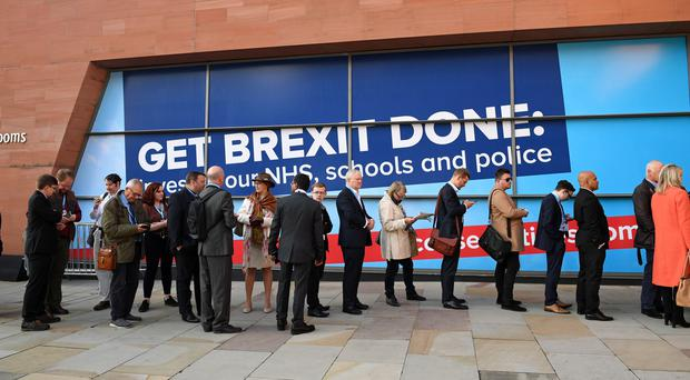People queuing outside the Manchester Convention Centre for the Conservative Party Conference, where Boris Johnson will set out his final Brexit offer, sticking to the October 31 deadline.