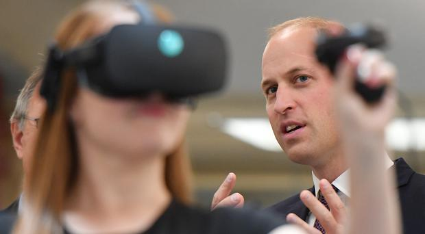 The Duke of Cambridge watches a virtual reality demonstration for a mental health programme at Oxford University (Daniel Leal-Olivas/PA)