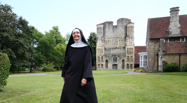 Mother Mary David walks in the grounds of St Mary's Abbey, also known as Malling Abbey, in West Malling, Kent. The way of life of the community of nuns is under threat from proposals to build a housing estate next to their secluded ancient home, campaigners have claimed.