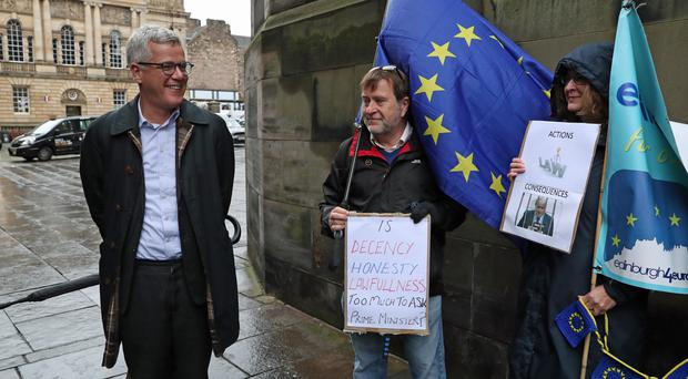 Jolyon Maugham QC with supporters of the action outside the Court of Session in Edinburgh (Andrew Milligan/PA)