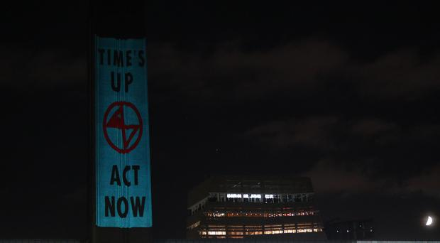Artwork was projected on the Tate Modern (Aaron Chown/PA)