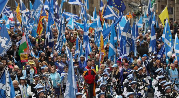 Scottish independence supporters march through Edinburgh during an All Under One Banner march (Andrew Milligan/PA)