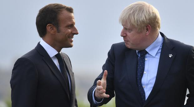 French President Emmanuel Macron speaks with Boris Johnson at the G7 (Neil Hall/PA)