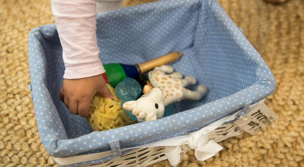 A child takes out a toy from a 'bite box' at the Tops Day Nursery in Corfe Mullan, Dorset (Andrew Matthews/PA)