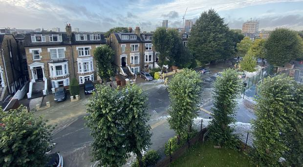 Flooding in Queens Drive, Finsbury Park (Steve Stubbs/PA)