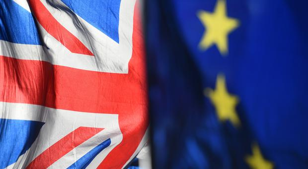 UK and European Union flags are flown outside the Houses of Parliament, London (PA)