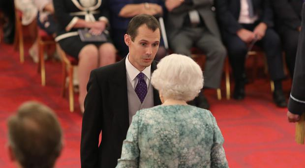 Christopher Jewell is decorated with the Queen's Gallantry Medal (Yui Mok/PA)