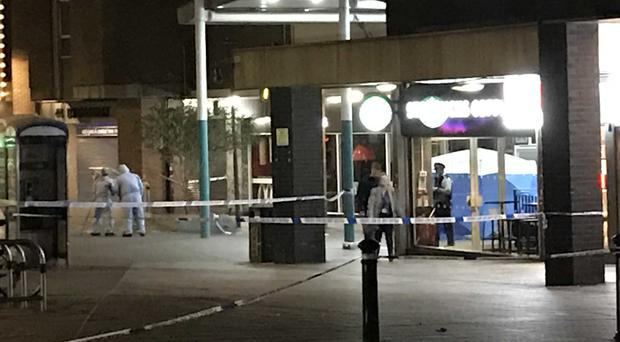 Police in Stratford, east London, after a teenager was fatally stabbed (Joe Gammie/PA)