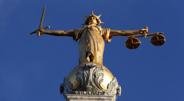 """Embargoed to 0001 Tuesday July 30 File photo dated 8/1/2019 of FW Pomeroy's Statue of Lady Justice atop the Central Criminal Court building at the Old Bailey, London. Lawyers fear the legal aid system is in """"crisis"""", with fewer people than ever before having access to justice."""