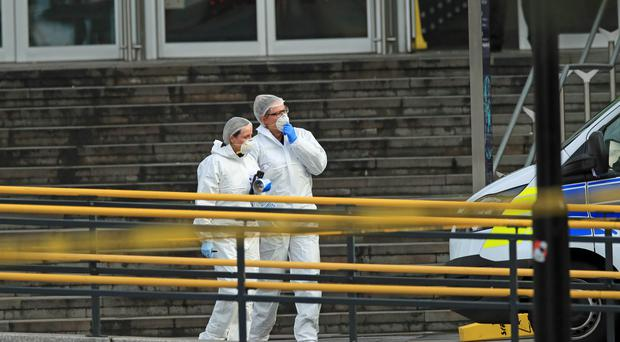 Forensic officers outside the Arndale Centre in Manchester where at least five people have been treated after a stabbing incident (Peter Byrne/PA)
