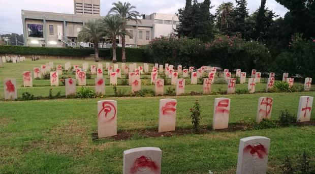 The vandalised Commonwealth war graves at Haifa cemetery in Israel (PA/Commonwealth War Graves Commission)