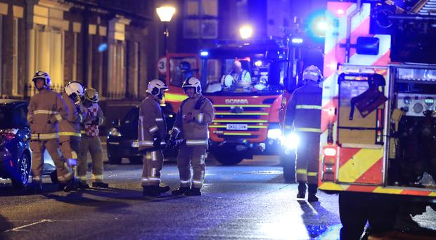 Emergency personnel in the street after a fire at the Rodney House care home (Peter Byrne/PA)