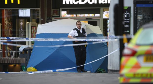 Police in Stratford, east London after a male teenager was fatally stabbed outside Stratford Broadway shortly after 3pm on Thursday (Aaron Chown/PA)