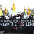 Protesters during a pro-Kurdish demonstration against Turkey at Parliament Square in London.