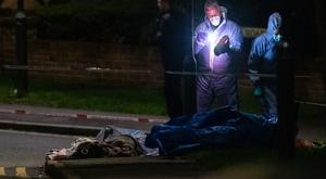Police forensics officers at the scene of a fatal stabbing on Barnehurst Avenue, in Bexley, south east London (Dominic Lipinski/PA)