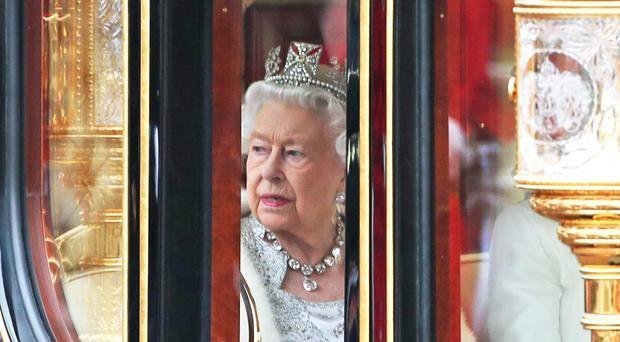 The Queen returns to Buckingham Palace in the Diamond Jubilee State Coach (Yui Mok/PA)