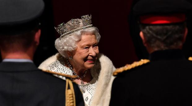 The Queen arrives through the Norman Porch for the State Opening of Parliament (Paul Ellis/PA)