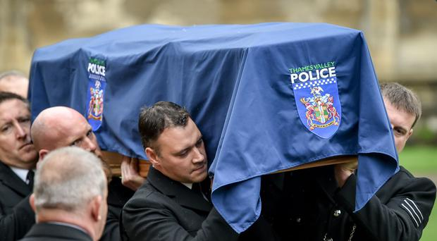 Pallbearers carrying the coffin of PC Andrew Harper arrive in the quadrangle at Christ Church Cathedral in St Aldate's, Oxford. (Steve Parsons / PA)