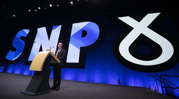 Deputy First Minister John Swinney delivers his address during the SNP autumn conference (Jane Barlow/PA)