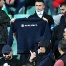 Bulgaria fans display a sweatshirt with the words No Respect at the England Buglaria game