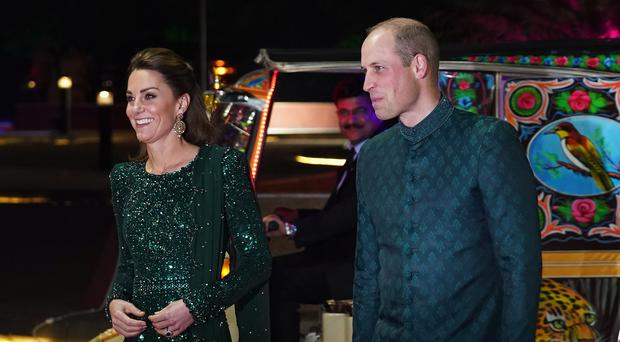 The Duke and Duchess of Cambridge arrive for a reception hosted by the British High Commissioner to Pakistan Thomas Drew (Owen Humphreys/PA)