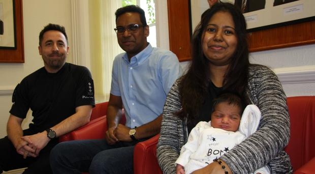 The newborn visited the police station with their parents on Tuesday (Essex Police)