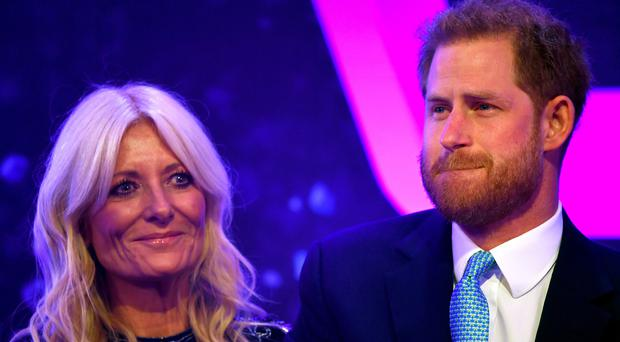 The Duke of Sussex reacts next to television presenter Gaby Roslin as he delivers a speech during the annual WellChild Awards (Toby Melville/PA)