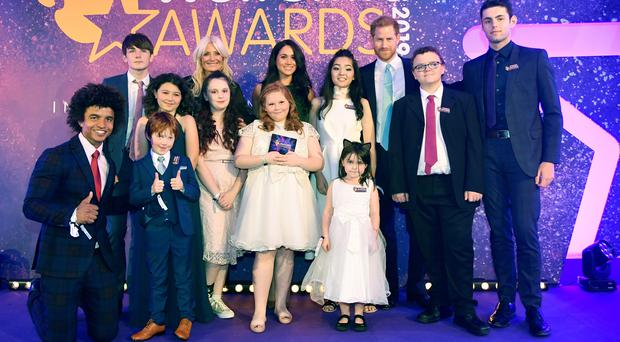The Duke and Duchess of Sussex with children at the WellChild awards (Toby Melville/P{A)