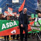 Asda workers marching through Leeds (Amy Murphy/PA)