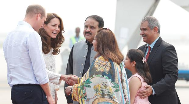 The Duke and Duchess of Cambridge arrive at the airport in Lahore (Peter Nicholls/PA)