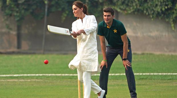 The Duchess of Cambridge keeps here eye on the ball during a game of cricket in Lahore (Owen Humphreys/PA)