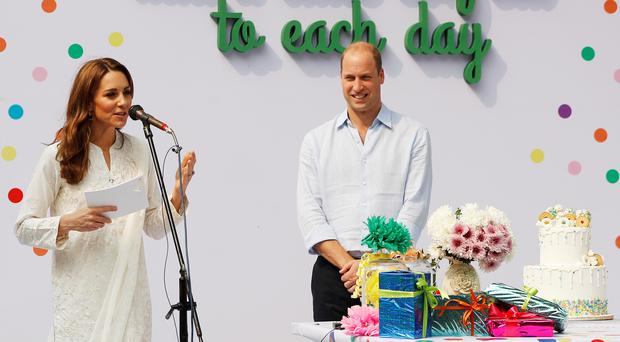 The Duke and Duchess of Cambridge during a visit to SOS Children's Village (Peter Nicholls/PA)