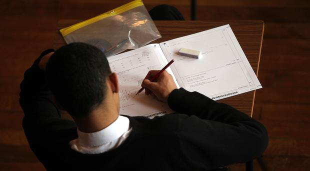 More than half of teenagers did not score a strong pass in both their maths and English GCSEs this year, official figures show (David Davies/PA)