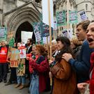 Campaigners trying to block Heathrow Airport expansion gathered outside the Royal Courts of Justice in March (PA/Kirsty O'Connor)