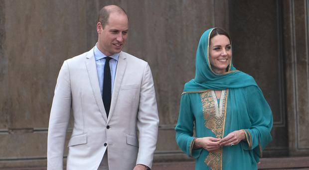 The Duke and Duchess of Cambridge during a visit to Badshahi Mosque before their flight