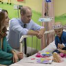 The Duke and Duchess of Cambridge with seven-year-old cancer patient Wafia Remain (Arthur Edwards/The Sun/PA)