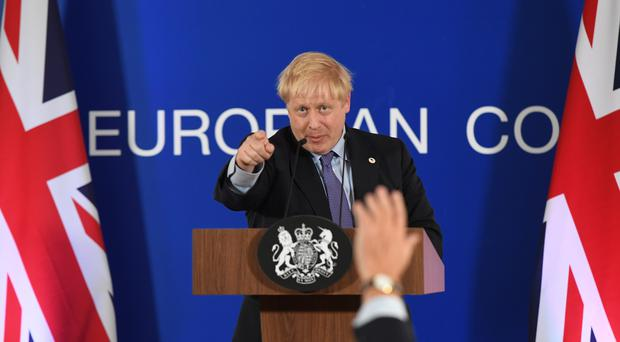 UK Prime Minister Boris Johnson speaking at the European Council summit at EU headquarters in Brussels (Stefan Rousseau/PA)