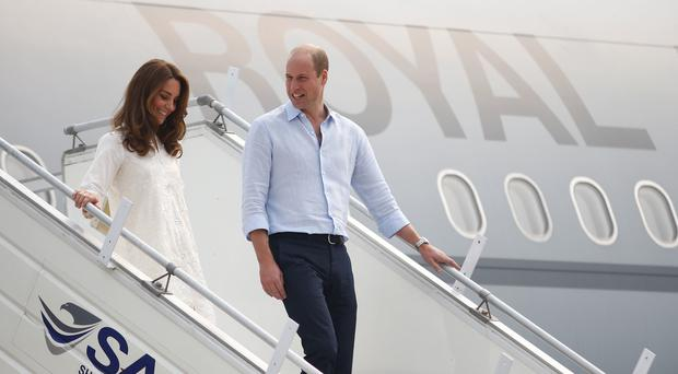 The plane carrying the Duke and Duchess of Cambridge was caught in a thunderstorm (Peter Nicholls/PA)