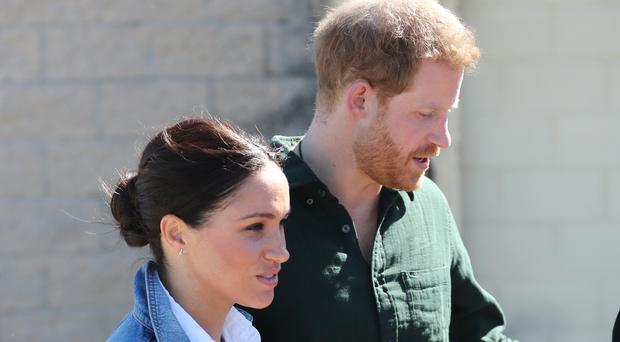 The Duke and Duchess of Sussex during a visit to Waves for Change at Monwabisi Beach in Cape Town, on day two of their tour of Africa.